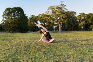yoga teacher in the grass